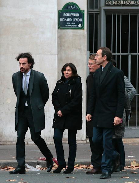 Paris mayor Anne Hidalgo (C) arrives at the scene of the Bataclan concert hall shootings on November 14, 2015, a day after a string of coordinated attacks left more than 120 people dead in the worst such violence in France's history (AFP Photo/Jacques DeMarthon)