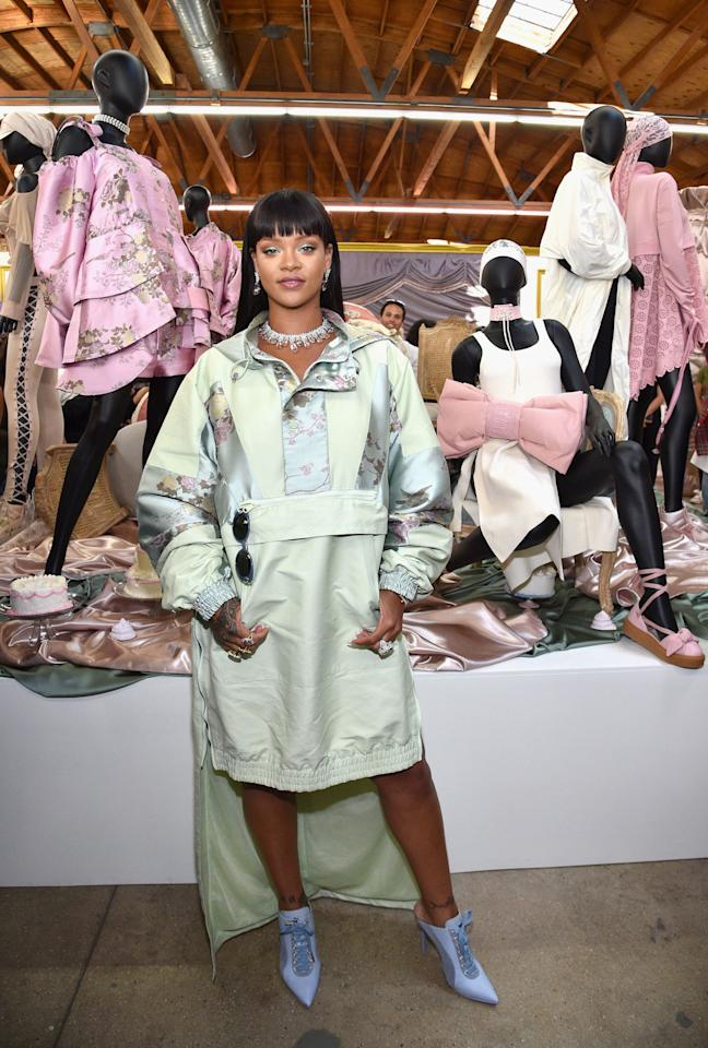 <p>RiRi surprised fans at her pop-up Fenty x Puma in L.A.donninga pale green windbreaker-style dress and pointed-toe sneaker style pumps,designed by none other than herself.</p>