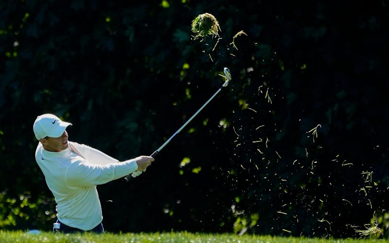 Rory McIlroy, of Northern Ireland, hits out of the rough on the 14th hole during the third round of the US Open - AP