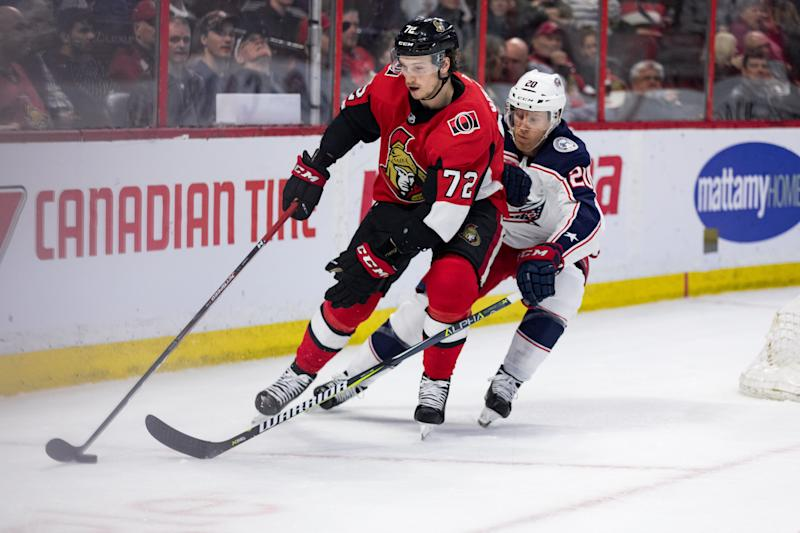 OTTAWA, ON - APRIL 06: Ottawa Senators Defenceman Thomas Chabot (72) protects the puck from Columbus Blue Jackets Winger Riley Nash (20) during third period National Hockey League action between the Columbus Blue Jackets and Ottawa Senators on April 6, 2019, at Canadian Tire Centre in Ottawa, ON, Canada. (Photo by Richard A. Whittaker/Icon Sportswire via Getty Images)