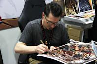 <p>Comic book artist Mark Brooks signing a poster of his design for fans at the Singapore Toy, Game and Comic Convention (STGCC) 2018 (PHOTO: Abdul Rahman Azhari/Yahoo Lifestyle Singapore) </p>