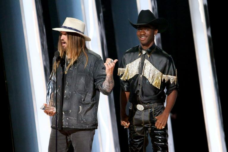 "2019 sensation Lil Nas X (R) along with country music veteran Billy Rae Cyrus nabbed a Country Music Award for ""Musical Event of the Year"""