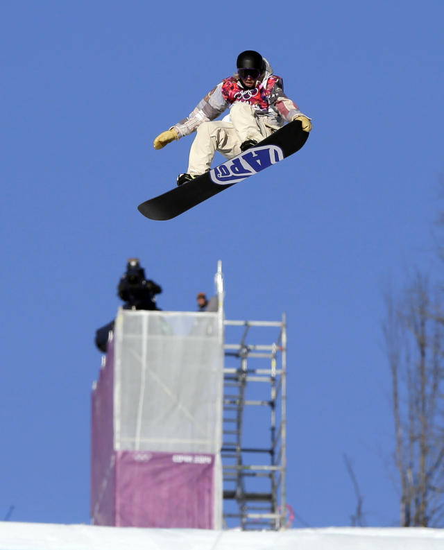 United States' Sage Kotsenburg takes a jump during the men's snowboard slopestyle semifinal at the Rosa Khutor Extreme Park, at the 2014 Winter Olympics, Saturday, Feb. 8, 2014, in Krasnaya Polyana, Russia. (AP)