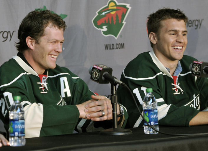 FILE - In this July 9, 2012, file photo, Minnesota Wild NHL hockey players Ryan Suter, left, and Zach Parise are introduced during a news conference in St. Paul, Minn. After signing with Minnesota together, Zach Parise and Ryan Suter are being bought out together. The Wild announced Tuesday, July 13, 2021, that the team is buying out the final four years of each player's contract, a stunning move early in the NHL offseason. (AP Photo/Jim Mone, File)