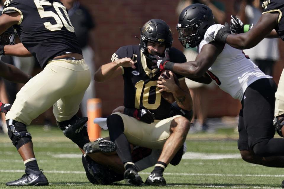 Wake Forest quarterback Sam Hartman is sacked by Louisville linebacker Jack Fagot during the first half of an NCAA college football game on Saturday, Oct. 2, 2021, in Winston-Salem, N.C. (AP Photo/Chris Carlson)