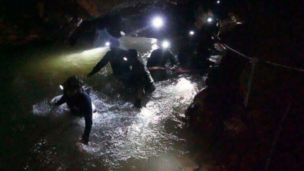 PHOTO: Thai rescue teams walk inside cave complex where 12 boys and their soccer coach went missing, in Mae Sai, Chiang Rai province, in northern Thailand, July 2, 2018. (Tham Luang Rescue Operation Center via AP)