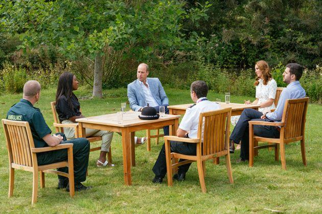 Prince William and Kate Middleton speak to representatives from groups who will receive money from the Royal Foundation's CAD $3 millionfund to support frontline workers and U.K. mental health.