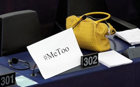 "A placard with the hashtag ""MeToo"" is seen on a European Parliament member's desk during a debate - Credit: Reuters"