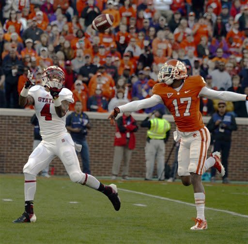 North Carolina State's Tobias Palmer, left, pulls in a reception for a touchdown while being covered by Clemson's Bashuad Breeland (17) during the first half of an NCAA college football game, Saturday, Nov. 17, 2012, in Clemson, S.C. (AP Photo/Richard Shiro)