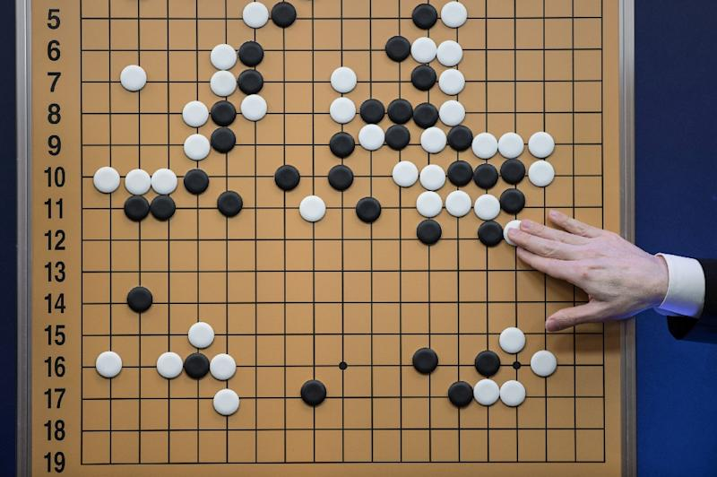 """The system learnt by itself, within mere days, to master the ancient Chinese board game known as """"Go"""" -- said to be the most complex two-person challenge ever invented (AFP Photo/Ed Jones)"""