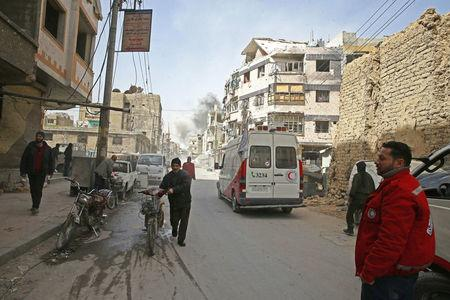 Smoke rises during evacuation in the besieged town of Douma