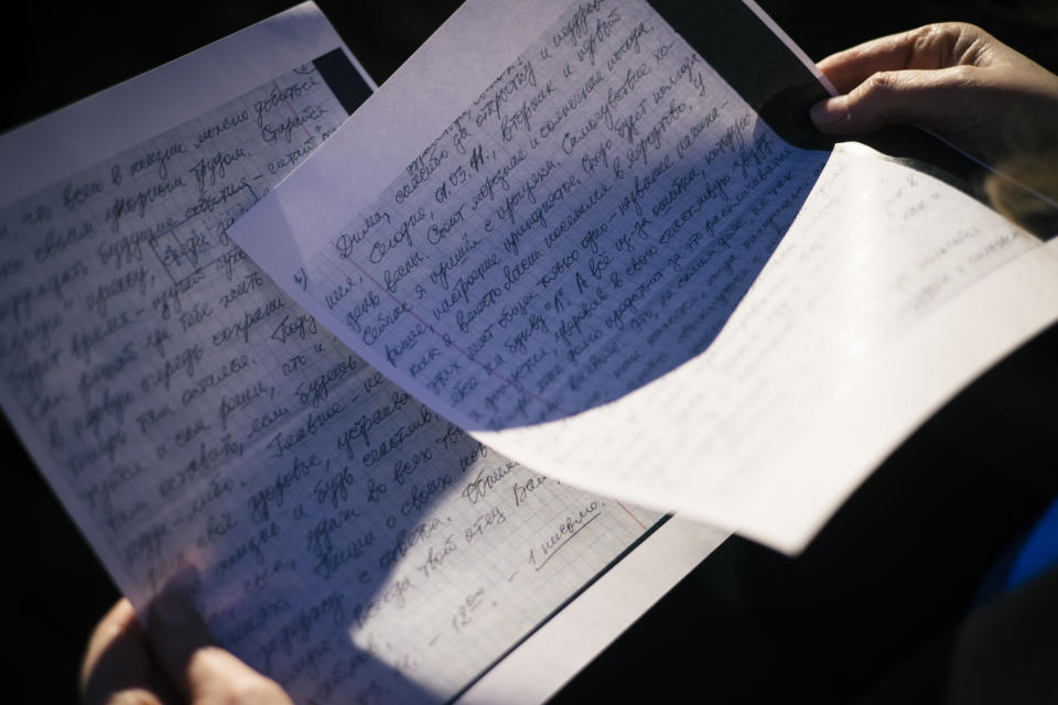 Lisa Sales holds a handwritten letter