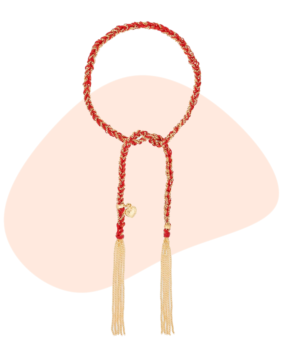 """This Carolina Bucci Love Lucy bracelet is perfect for the mom that likes to keep it simple. Handmade in Florence, the silk is strung with a love heart charm – she can layer it with her other jewelry and it will always symbolize your love for her. $950, Net-A-Porter. <a href=""""https://www.net-a-porter.com/en-us/shop/product/carolina-bucci/jewelry-and-watches/bracelets/love-lucky-18-karat-gold-and-silk-bracelet/17957409491487940"""" rel=""""nofollow noopener"""" target=""""_blank"""" data-ylk=""""slk:Get it now!"""" class=""""link rapid-noclick-resp"""">Get it now!</a>"""