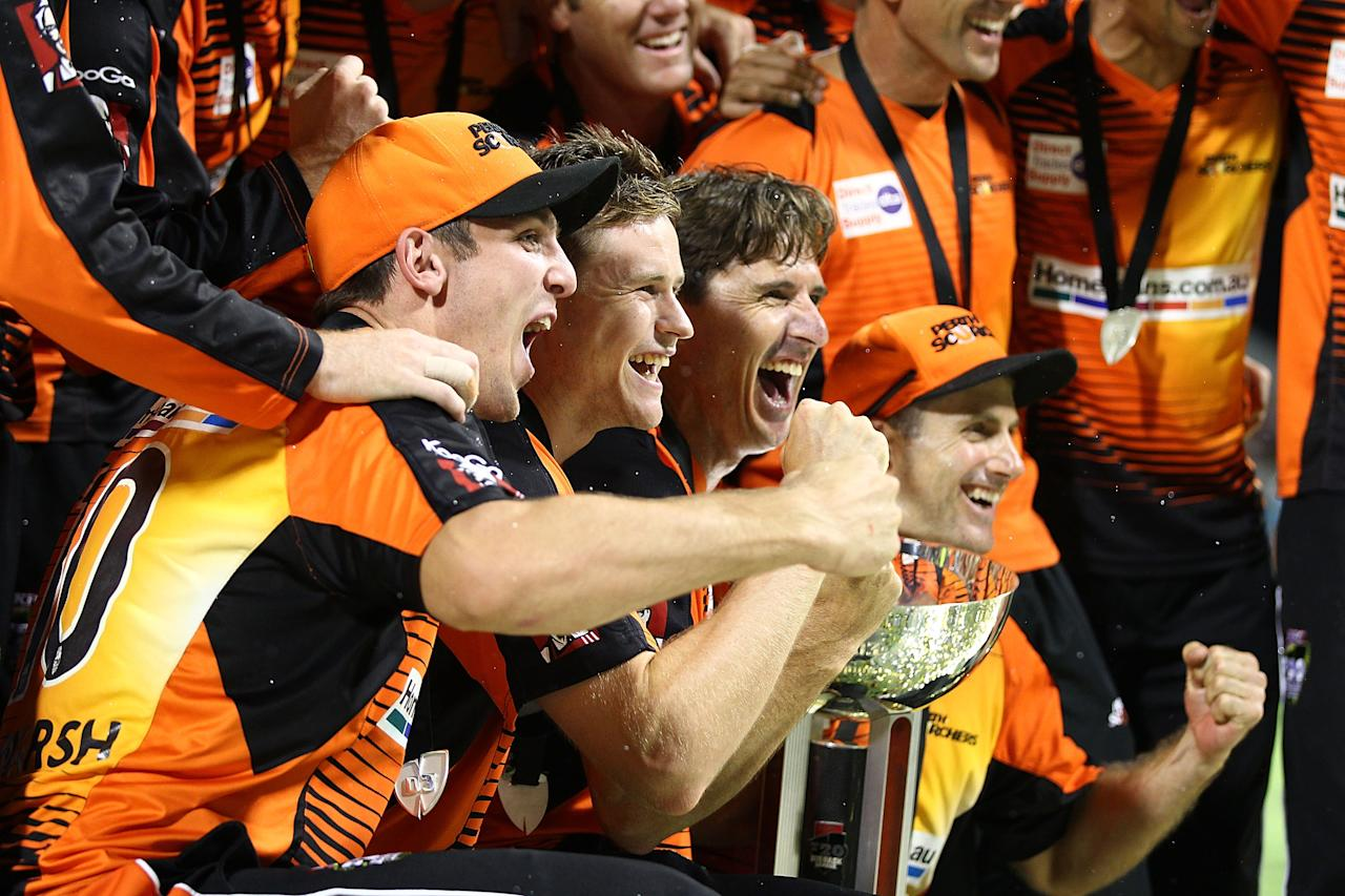 PERTH, AUSTRALIA - FEBRUARY 07: The Scorchers celebrate after defeating the Hurricanes during the Big Bash League Final match between the Perth Scorchers and the Hobart Hurricanes at WACA on February 7, 2014 in Perth, Australia.  (Photo by Will Russell/Getty Images)