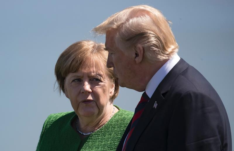 German Chancellor Angela Merkel and US President Donald Trump who fiercely criticised the veteran German leader over her immigation policy which has sharply the German government (AFP Photo/)