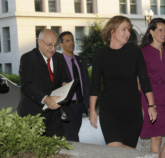 Israeli Justice Minister Tzipi Livni, right, and Yitzhak Molcho, left, chief negotiator on the Israeli negotiating team with the Palestinians, arrive at the State Department in Washington, Monday, July 29, 2013. (AP Photo/Pablo Martinez Monsivais)