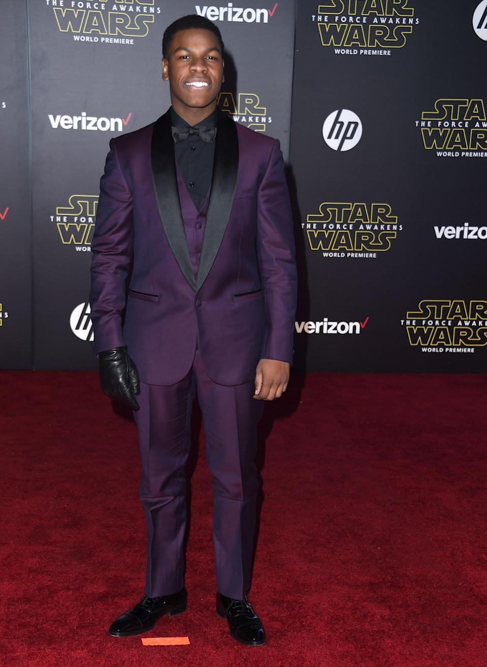 <p>Boyega, who plays Finn in the new <i>Star Wars </i>movie, wore a three piece purple suit and one leather glove to its LA premiere.</p><p><i>Photo: Getty Images</i><br></p>