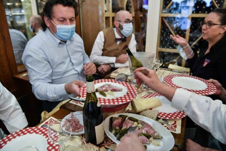 """A traditional morning meal inside a """"bouchon"""", a restaurant typical of Lyon in southeastern france."""