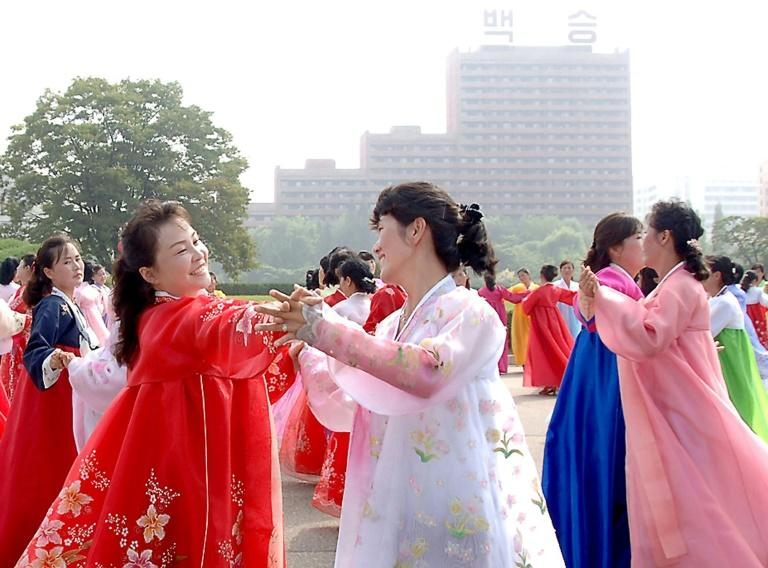 Members of North Korean women's union hold a dance party in Pyongyang to celebrate national day