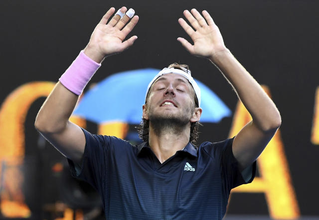 France's Lucas Pouille celebrates after defeating Canada's Milos Raonic in their quarterfinal match at the Australian Open tennis championships in Melbourne, Australia, Wednesday, Jan. 23, 2019.(AP Photo/Andy Brownbill)