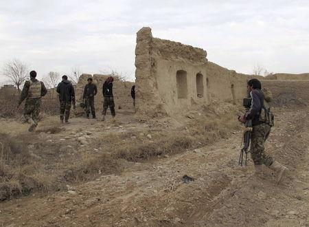 Afghan National Army (ANA) soldiers patrol at an outpost in Helmand province, Afghanistan, in this December 25, 2015 file photo. REUTERS/Abdul Malik/Files
