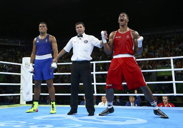 2016 Rio Olympics - Boxing - Final - Men's Super Heavy (+91kg) Final Bout 273 - Riocentro - Pavilion 6 - Rio de Janeiro, Brazil - 21/08/2016. Tony Yoka (FRA) of France celebrates after winning his bout against Joseph Joyce (GBR) of Britain. REUTERS/Peter Cziborra FOR EDITORIAL USE ONLY. NOT FOR SALE FOR MARKETING OR ADVERTISING CAMPAIGNS.