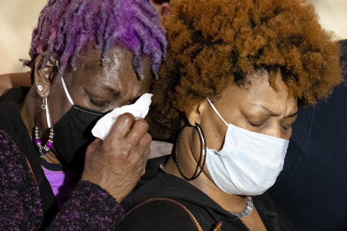 Angie Golson, grandmother of Daunte Wright, cries on the shoulder of Naisha Wright, right, during a news conference at New Salem Missionary Baptist Church, Thursday, April 15, 2021, in Minneapolis. (AP Photo/John Minchillo)