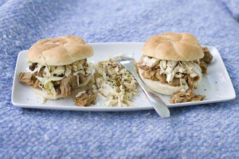 This July 15, 2013 photo shows a North Carolina-style pulled pork sandwich with North Carolina barbecue sauce and coleslaw. (AP Photo/Matthew Mead)