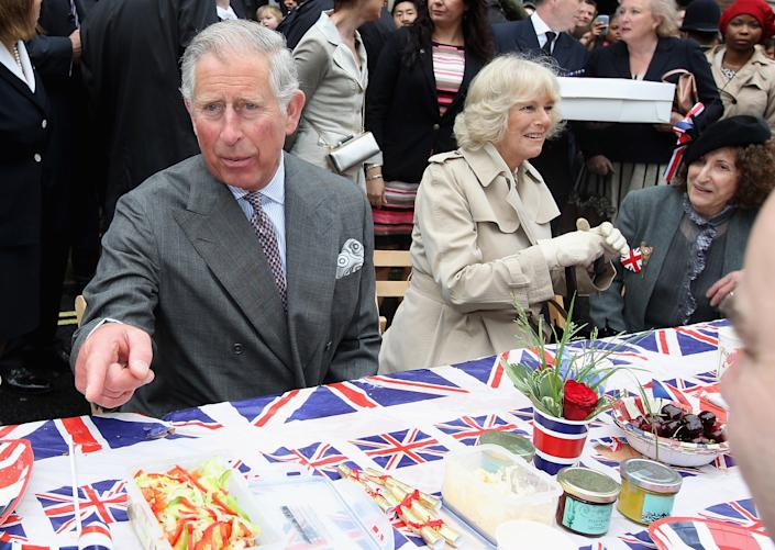 LONDON, ENGLAND - JUNE 03:  Prince Charles, Prince of Wales and Camilla, Duchess of Cornwall attend the 'Big Jubilee Lunch' in Piccadilly ahead of the Diamond Jubilee River Pageant on June 3, 2012 in London, England. For only the second time in its history the UK celebrates the Diamond Jubilee of a monarch. Her Majesty Queen Elizabeth II celebrates the 60th anniversary of her ascension to the throne. Thousands of well-wishers from around the world have flocked to London to witness the spectacle of the weekend's celebrations. The Queen along with all members of the royal family will participate in a River Pageant with a flotilla of a 1,000 boats accompanying them down The Thames.  (Photo by Chris Jackson - WPA Pool/Getty Images)
