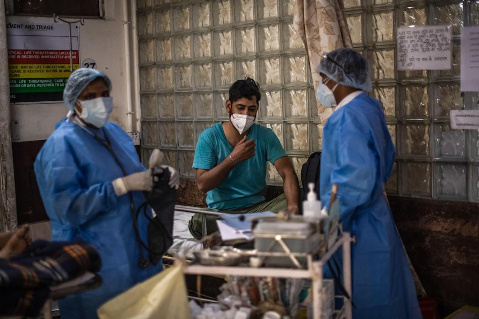 <p>Medical staff attend to Covid-19 positive patients in the emergency ward of a hospital in Delhi, India, 6 May, 2021</p> (Getty Images)