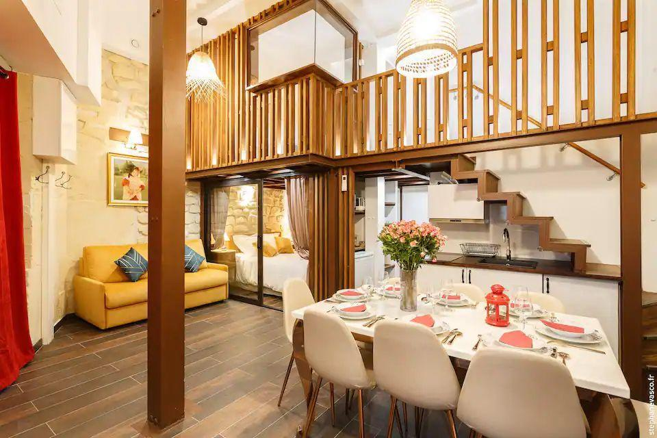 """<p>Next to the Holy Trinity Church in a district rich with architecture and history, this Parisian Airbnb is ideal for exploring the French capital as a group. It's modern and functional in style, while respecting the charm of the Belle Epoque. The cosy rental is loved by past guests for being a fantastic space for families.</p><p><strong>Sleeps: </strong>8</p><p><strong>Price per night: </strong>£196</p><p><a class=""""link rapid-noclick-resp"""" href=""""https://airbnb.pvxt.net/15Dj5z"""" rel=""""nofollow noopener"""" target=""""_blank"""" data-ylk=""""slk:SEE INSIDE"""">SEE INSIDE</a></p>"""