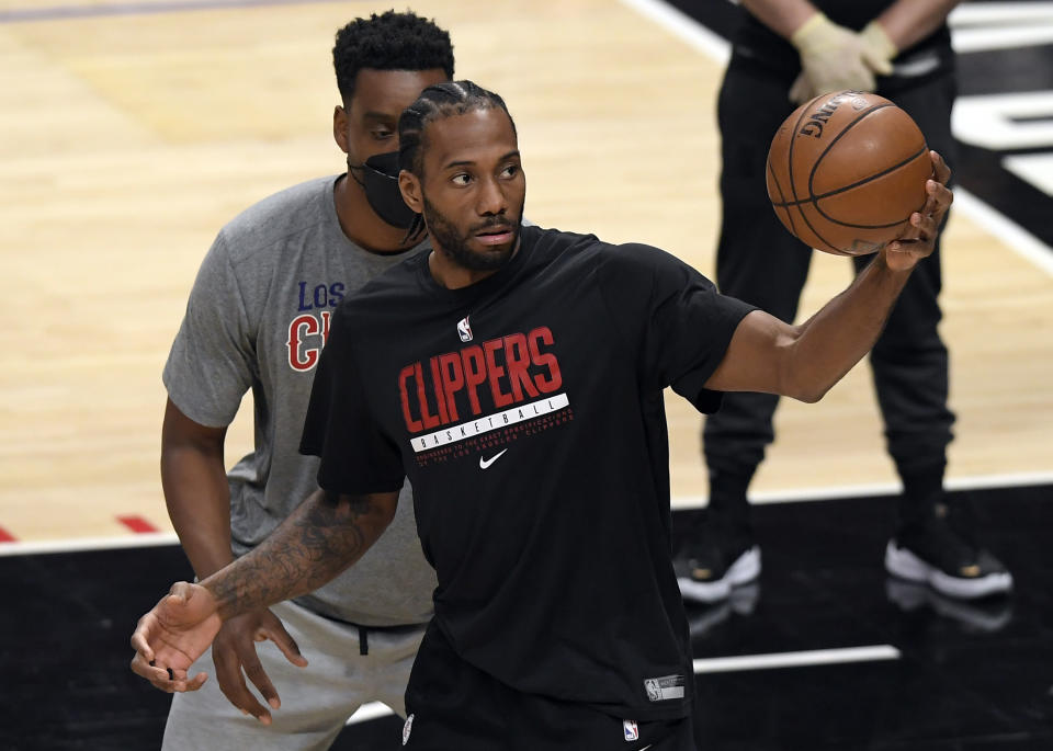 Kawhi Leonard #2 of the Los Angeles Clippers warms up before the start of Game Four of the Western Conference second-round playoff series against Utah Jazz at Staples Center on June 14, 2021 in Los Angeles, California. NOTE TO USER: User expressly acknowledges and agrees that, by downloading and or using this photograph, User is consenting to the terms and conditions of the Getty Images License Agreement. (Photo by Kevork Djansezian/Getty Images)