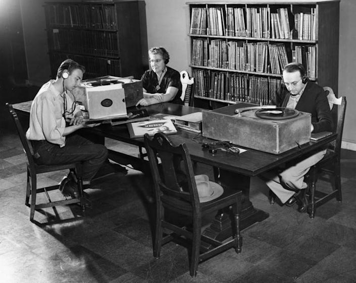 """Visitors listen to music at the Los Angeles Public Library in this undated photo. <span class=""""copyright"""">(Security Pacific National Bank Collection/Los Angeles Public Library)</span>"""