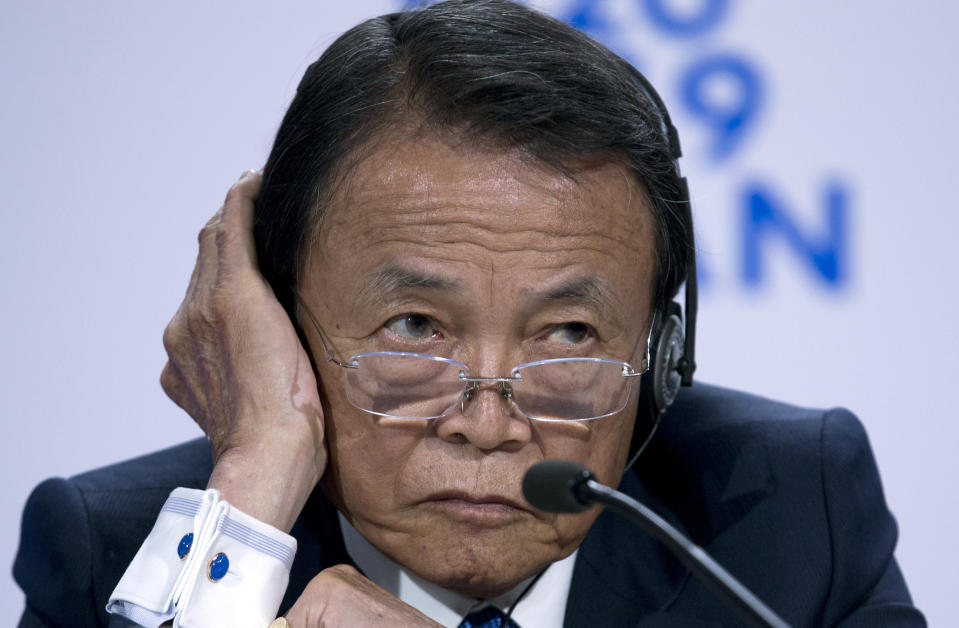 Japan's Finance Minister Taro Aso listens during a news conference in the sidelines of the World Bank/IMF Annual Meetings in Washington, Friday, Oct. 18, 2019. (AP Photo/Jose Luis Magana)