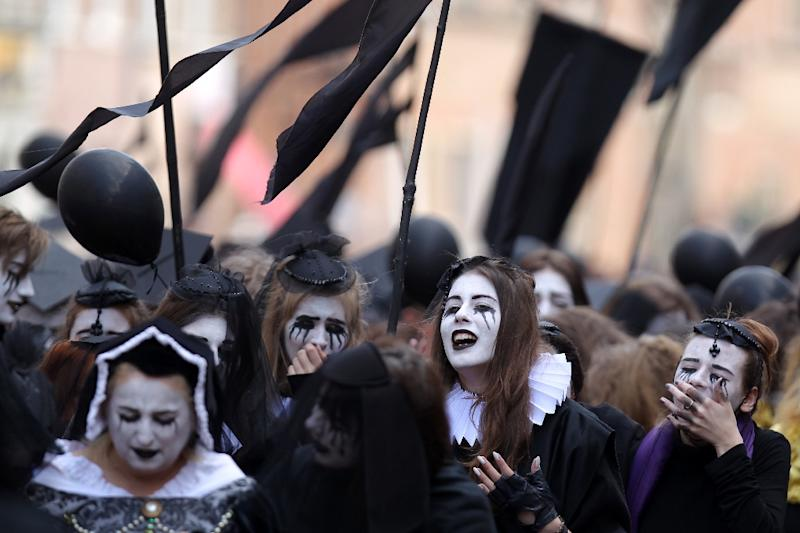 Costumed mourners march on the streets in Gdansk, Poland, to mark the 400th anniversary of the death of William Shakespeare