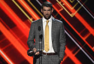 "FILE - Michael Phelps accepts the award for best record-breaking performance at the ESPYS on July 12, 2017, in Los Angeles. Olympians including Phelps, Apolo Ohno and Jeremy Bloom are opening up about their mental health struggles in a new sobering documentary about suicide and depression among the world's greatest athletes. Many of the athletes are sharing their pain for the first time in HBO's ""The Weight of Gold,"" which aims to expose the problem, incite change among Olympics leadership and help others experiencing similar issues feel less alone. (Photo by Chris Pizzello/Invision/AP, File)"