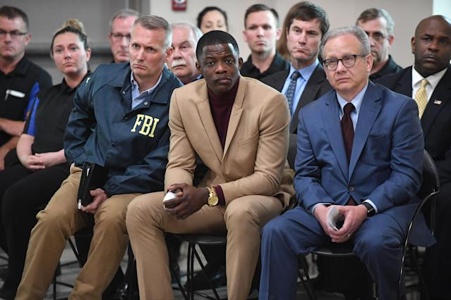 <p>Waffle House patron James Shaw, Jr. (C) who stopped the shooting at a Waffle House where a gunman opened fire killing four and injuring two attends a press conference with FBI Special Agent In Charge, Matthew Espenshade (L) and Metro Nashville Mayor David Briley (right) on April 22, 2018 in Nashville, Tennessee. Shaw, Jr., 29, took action disarming the gunman and ultimately forcing him out of the Waffle House restaurant. Travis Reinking, 29, of Morton, IL, is person of interest in the shooting and is suspected to have left the scene naked. (Photo: Jason Davis/Getty Images) </p>