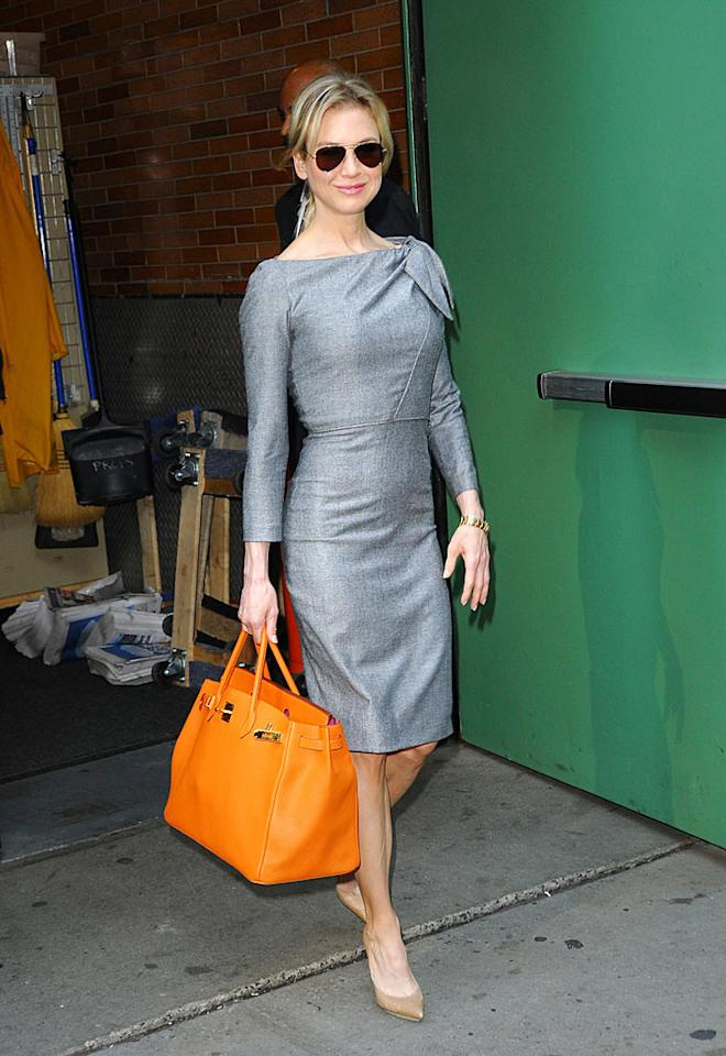 """Earlier that day, the A-list actress looked red-carpet-ready as she strolled through NYC in another one of Carolina's creations. She completed her ensemble with her favorite pumps, aviator sunglasses, and a monstrous orange Birkin bag. Jackson Lee/<a href=""""http://www.splashnewsonline.com"""" target=""""new"""">Splash News</a> - August 18, 2009"""