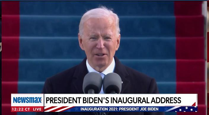 Biden speaks into microphones in a still from the Newsmax broadcast of his inaugural address