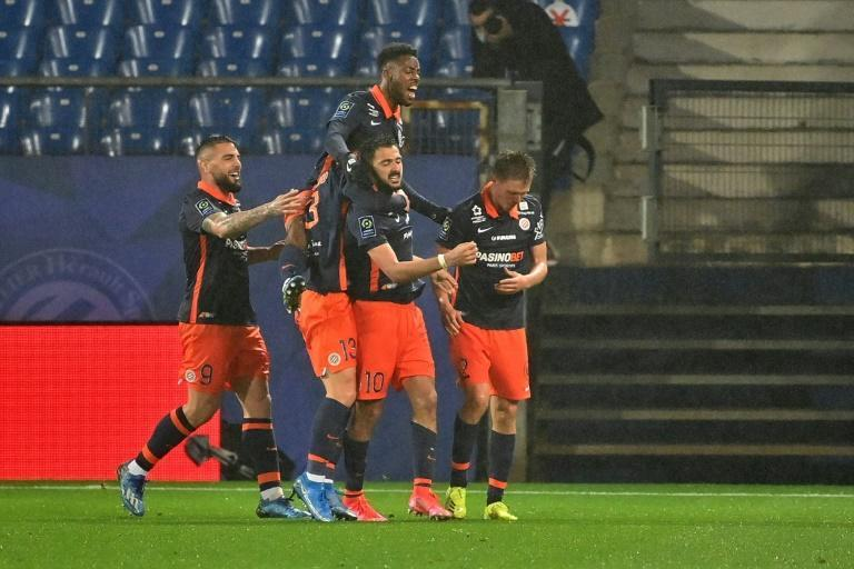 Gaetan Laborde celebrates after scoring in stoppage time as Montpellier drew 3-3 with Marseille