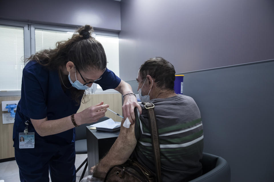 RAMAT GAN, ISRAEL - JULY 14:  A man receives his third dose of COVID19 vaccine at Sheba Medical Center on July 14, 2021 in Ramat Gan, Israel. This week the country started offering third doses of the Pfizer Covid-19 vaccine to adults with weak immune systems, due to concern about the more virulent Delta variant.  (Photo by Amir Levy/Getty Images)