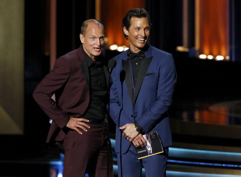 Matthew McConaughey and Woody Harrelson (L) present the award for Outstanding Lead Actor In A Miniseries Or A Movie during the 66th Primetime Emmy Awards in Los Angeles, California August 25, 2014. REUTERS/Mario Anzuoni (UNITED STATES - Tags: ENTERTAINMENT) (EMMYS-SHOW)