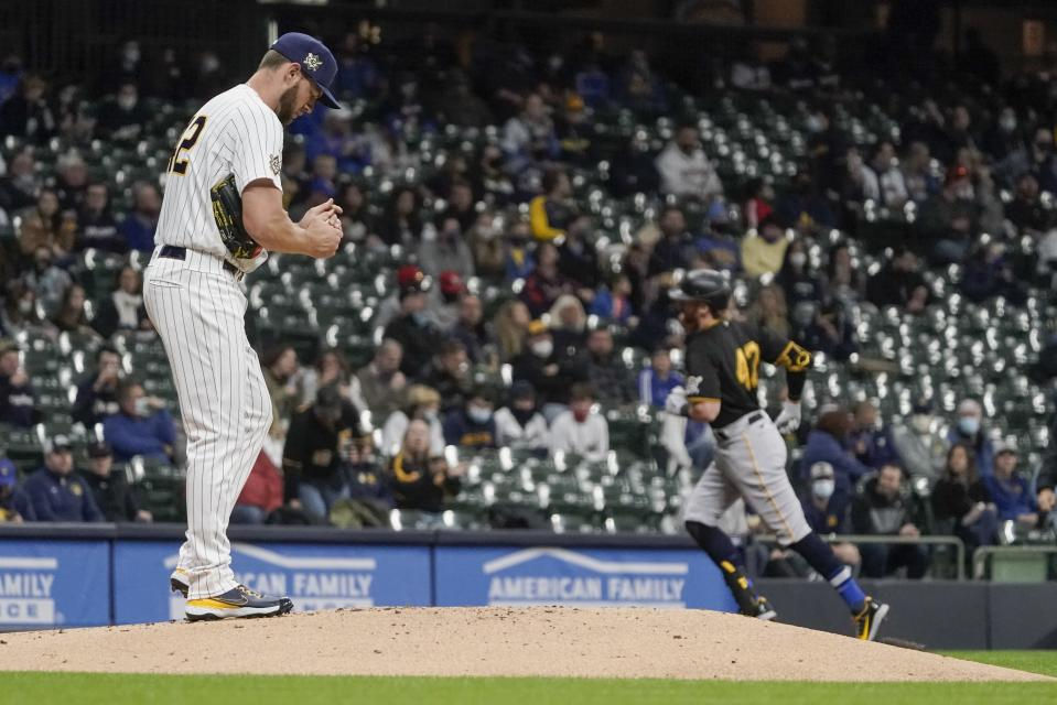 Milwaukee Brewers starting pitcher Adrian Houser reacts after giving up a home run to Pittsburgh Pirates' Colin Moran during the second inning of a baseball game Friday, April 16, 2021, in Milwaukee. (AP Photo/Morry Gash)