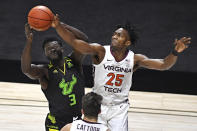 South Florida's Prince Oduro, left, and Virginia Tech's Justyn Mutts reach for the ball in the first half of an NCAA college basketball game, Sunday, Nov. 29, 2020, in Uncasville, Conn. (AP Photo/Jessica Hill)