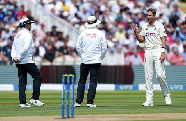 Stuart Broad (right) speaks to the umpires after New Zealand's Devon Conway was given not out