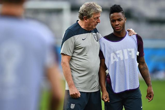 England's coach Roy Hodgson (L) speaks to midfielder Raheem Sterling during a training session in Belo Horizonte on June 23, 2014 (AFP Photo/Ben Stansall)