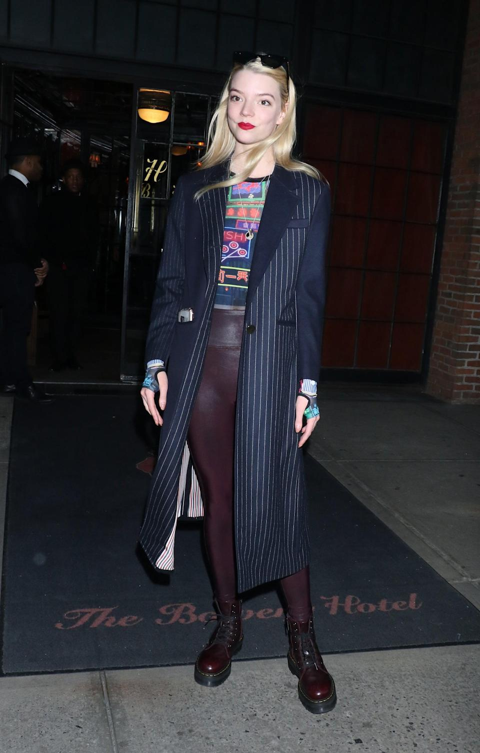 <p>Anya turned up the edge for a night out in New York City, styling maroon leggings with her trusty Dr. Martens and completing the outfit with an electrifying long-sleeved graphic tee.</p>