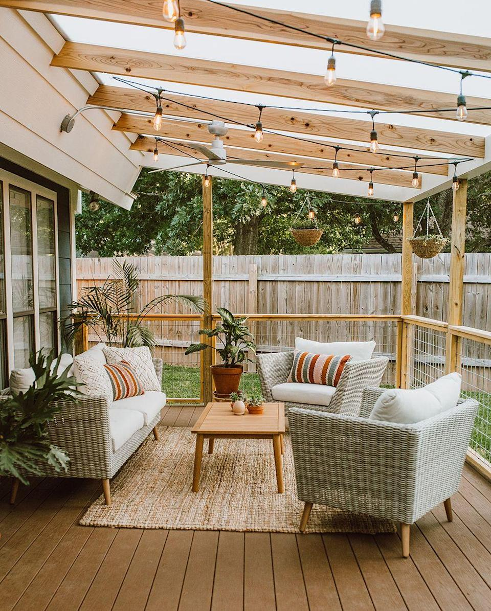 """<p>Cozy up your backyard with comfy outdoor furniture and strands of string lights hanging from above. This just became your new favorite room in the house.</p><p><strong>See more at <a href=""""http://livvyland.com/2018/05/31/before-after-covered-patio-renovation-makeover/"""" rel=""""nofollow noopener"""" target=""""_blank"""" data-ylk=""""slk:LivvyLand"""" class=""""link rapid-noclick-resp"""">LivvyLand</a>.</strong></p><p><a class=""""link rapid-noclick-resp"""" href=""""https://www.amazon.com/Backyard-Hanging-Outdoor-Pergola-Deckyard/dp/B00RQHBZVS/ref=sr_1_12?tag=syn-yahoo-20&ascsubtag=%5Bartid%7C10050.g.3404%5Bsrc%7Cyahoo-us"""" rel=""""nofollow noopener"""" target=""""_blank"""" data-ylk=""""slk:SHOP STRING LIGHTS"""">SHOP STRING LIGHTS</a></p>"""