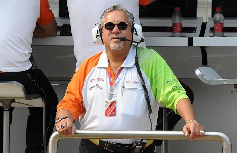 Force India-Mercedes Team Principal Vijay Mallya watches the big screen during a practice session of Formula One's Indian Grand Prix, at the Buddh International circuit in Greater Noida, on October 28, 2011 (AFP Photo/Prakash Singh)