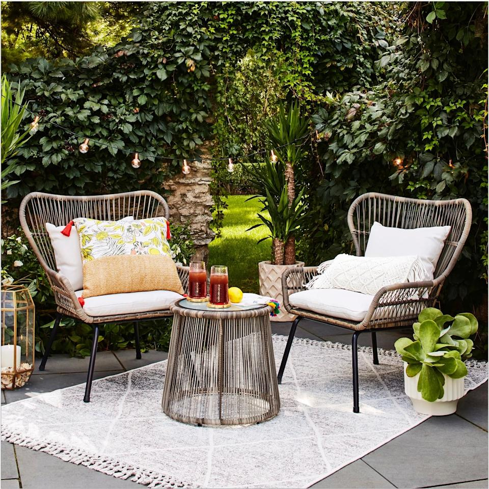 """<p>The wingback chairs in the <a href=""""https://www.popsugar.com/buy/Latigo-Rattan-Patio-Chat-Set-542610?p_name=Latigo%20Rattan%20Patio%20Chat%20Set&retailer=target.com&pid=542610&price=350&evar1=casa%3Aus&evar9=46144610&evar98=https%3A%2F%2Fwww.popsugar.com%2Fhome%2Fphoto-gallery%2F46144610%2Fimage%2F47161351%2FLatigo-Rattan-Patio-Chat-Set&list1=shopping%2Ctarget%2Csmall%20spaces%2Csmall%20space%20living%2Capartment%20living%2Coutdoor%20decorating%2Caffordable%20decor%2Chome%20shopping&prop13=mobile&pdata=1"""" rel=""""nofollow"""" data-shoppable-link=""""1"""" target=""""_blank"""" class=""""ga-track"""" data-ga-category=""""Related"""" data-ga-label=""""https://www.target.com/p/latigo-3pc-rattan-patio-chat-set-brown-opalhouse-8482/-/A-53788889"""" data-ga-action=""""In-Line Links"""">Latigo Rattan Patio Chat Set</a> ($350) make for a relaxing place to sit.</p>"""